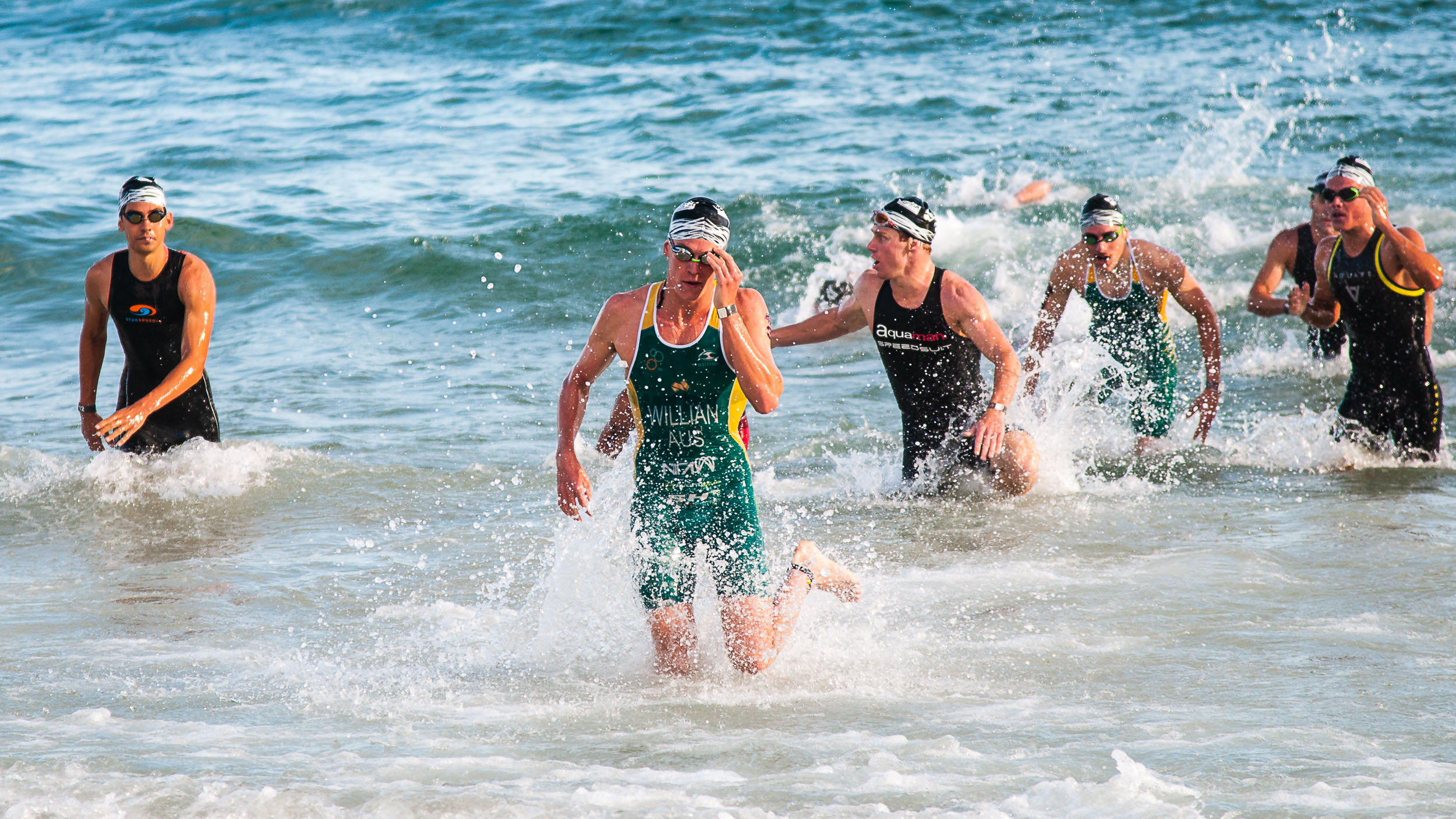 Elite men finishing the swim leg, Noosa Triathlon, 2016